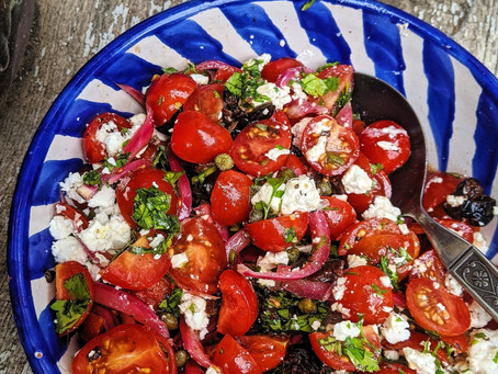 Tomato, black olive, caper, feta and pickled red onion salad with mint