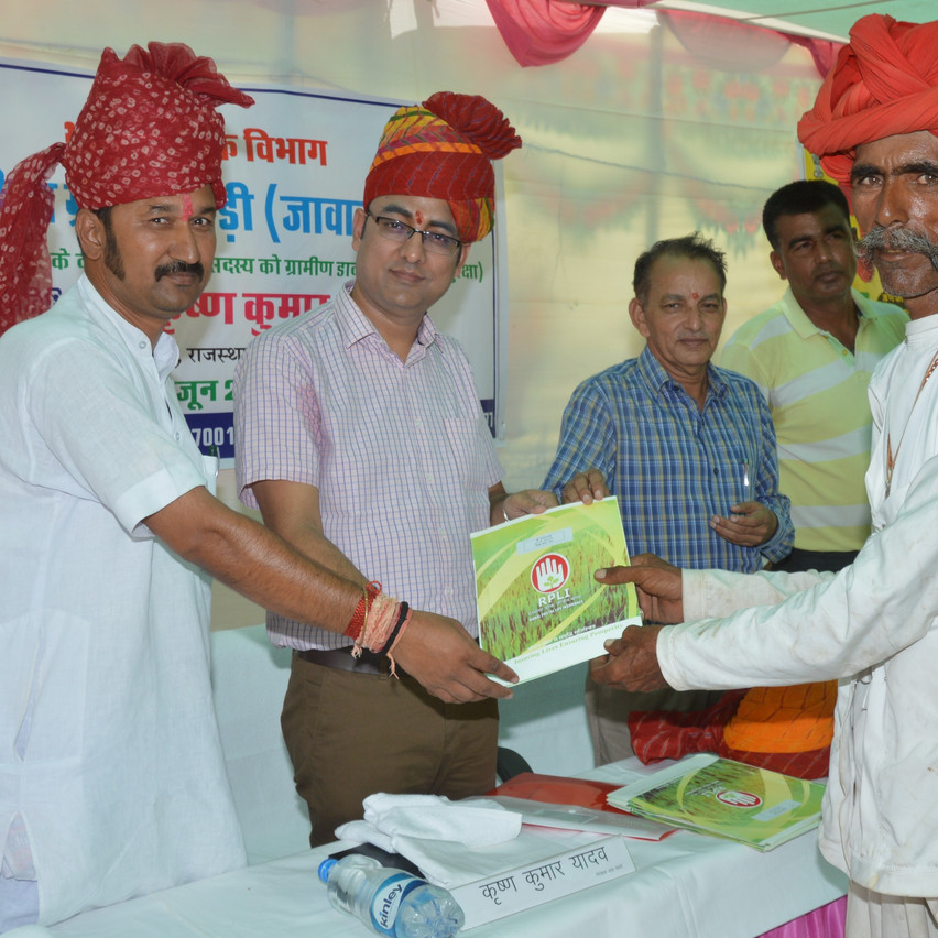 Director Postal KK Yadav distributing Policy Bond to villagers