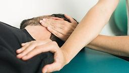 Physiotherapist doing massage and stretc