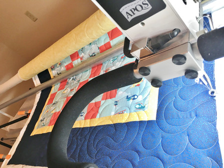 Quilt on APQS longarm machine