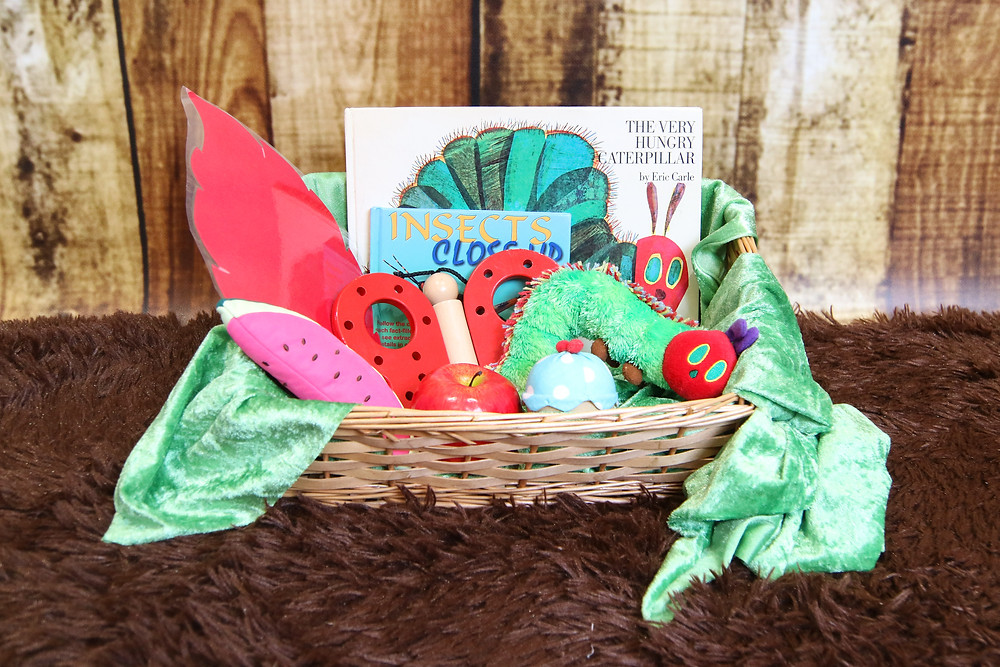 The contents of a Hungry Caterpillar Story Basket