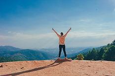 woman-standing-on-cliff-1134190.jpg