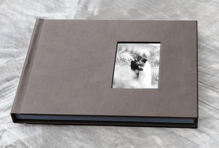 Leatherette cover with photo window.