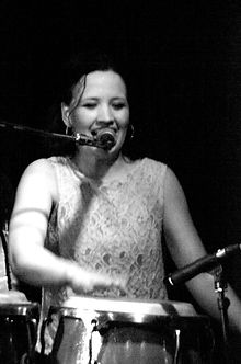 Lilli Elina, playing percussion and singing with the only all-female salsa band in London, UK.