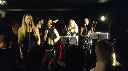 Lilli Elina, playing bass with Guerrera, the only all-women, all-female salsa band in London, UK.
