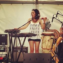 Lilli Elina, multi-instrumentalist based in London, playing piano and percussion at the same time.