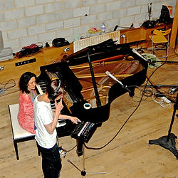 Lilli Elina, pianist, at Fish Factory studio, London, recording the piano with producer Leon Brichard.