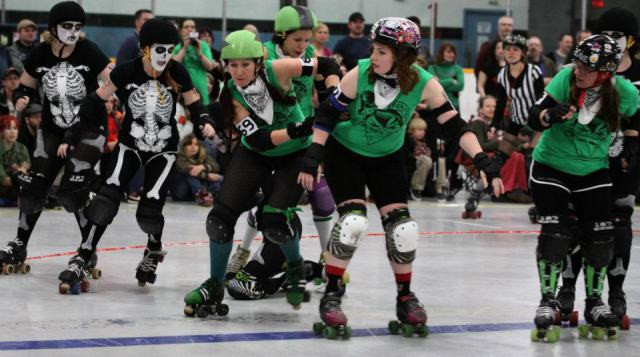 Jammer Foxy Roller (#69, Las Bandidas Locas) uses one of her team mates (Straight No-Chase'Her, #80) to get through the pack. Photo by Andrea Crowell