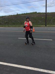 Kim roller skating on a street