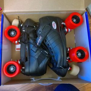 A pair of skates in a box