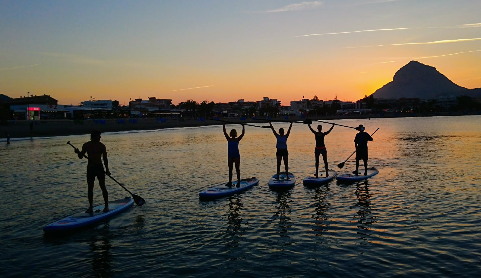 Sunset stand up paddle boarding