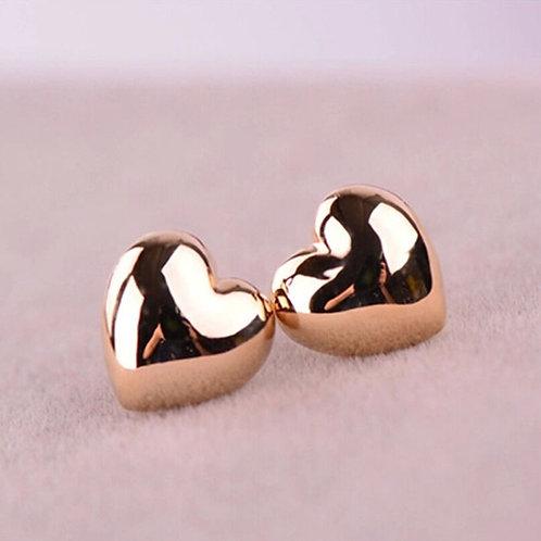 Brincos dourados estilo coração