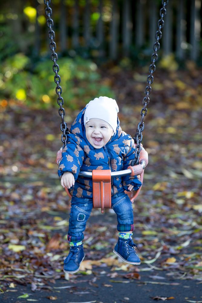 Playing on swing