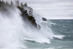 Water and waves bouncing off the cliffs on Georgian Bay during a storm