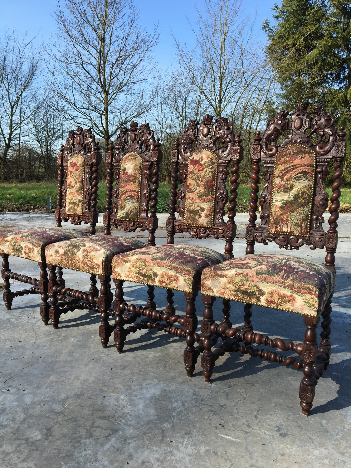4 carved hunting chairs