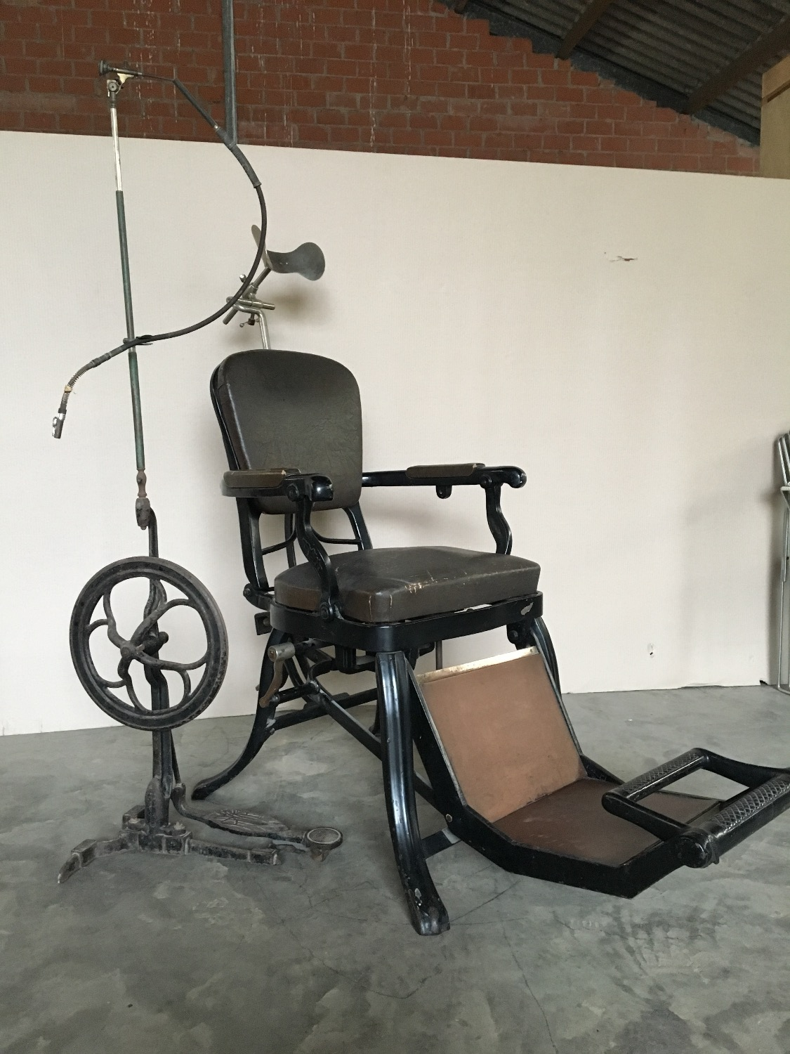 antique dentist chair with drill