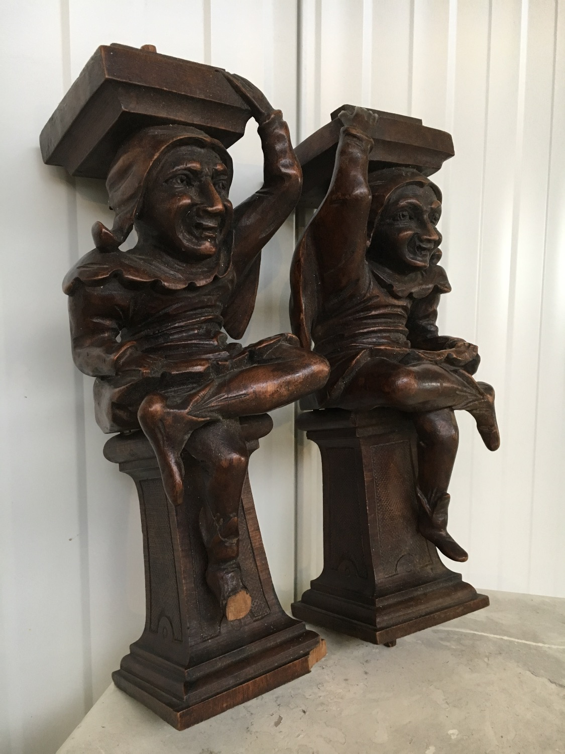 pair of antique jesters in wood