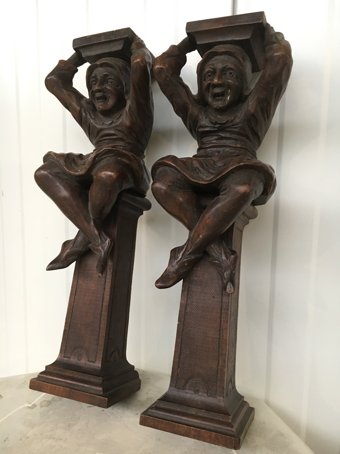 Pair of jester figures in wood