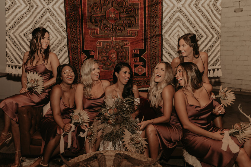 laughing bridal party