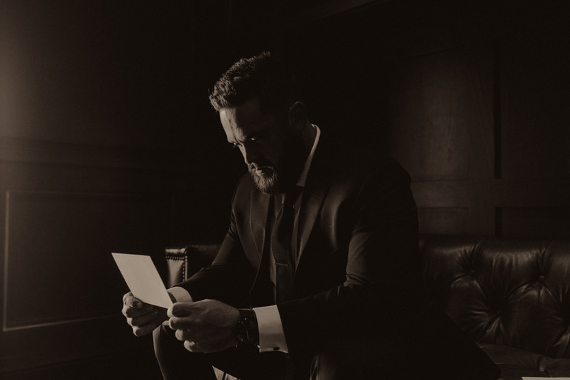 groom reading brides letter