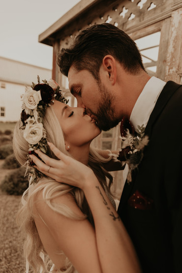 kissing portraits of bride and groom