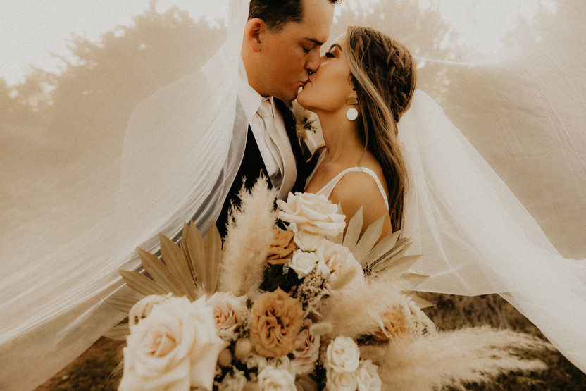 wedding kissing portrait
