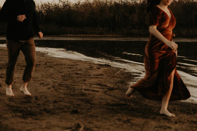 groom chasing bride on lake