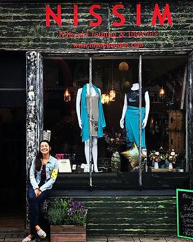 Shopfront with Em.JPG