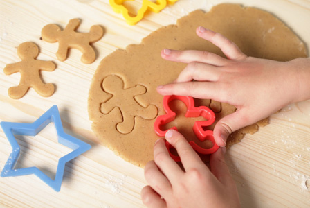 child-cutting-cookies-with-cookie-cutter-horiz_r6g4oy