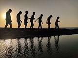 backlit-beach-children-939700.jpg