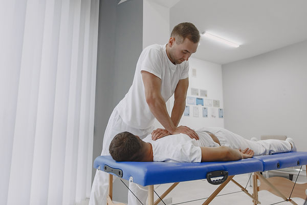 man-medical-office-physiotherapist-is-rehabilitating-back.jpg