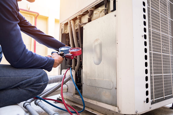 technician-is-checking-air-conditioner-measuring-equipment-filling-air-conditioners.jpg