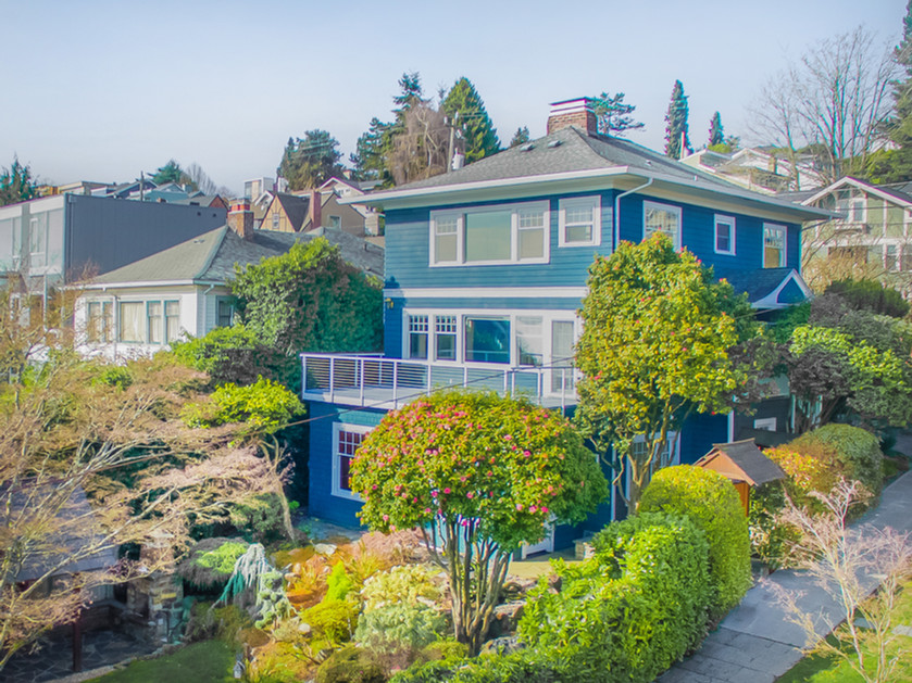 Spring has sprung at this gorgeous house in Leschi and its oasis like yard.