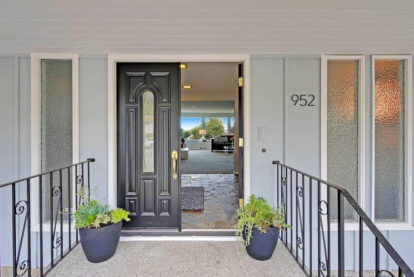 Past these doors is almost 5000 square feet of mid-century cool. And big views as a cherry on top...