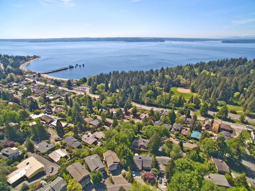 Private path to Lincoln Park and views galore come with this great house in West Seattle