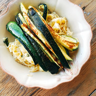 Pasta with roasted courgettes, lemon, Parmesan and herbs