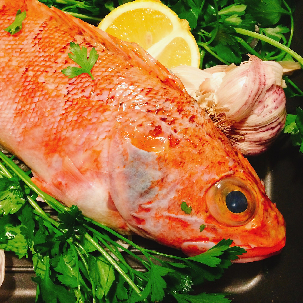 Roasted red snapper with lentils and marinated red peppers