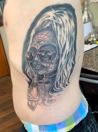 Black and grey ribs tattoo.jpg