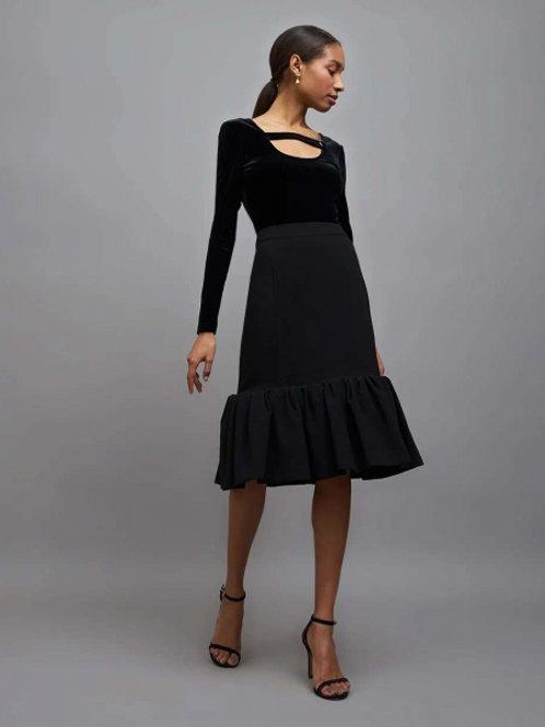 Черная юбка с миди воланом