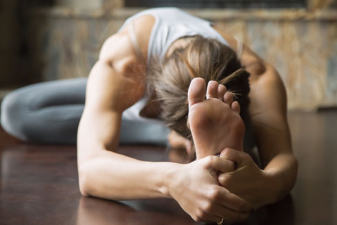 Close up of young woman practicing yoga,