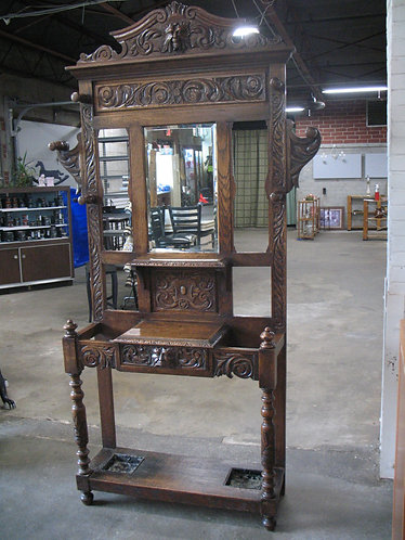 Antique Carved Face Oak Hall Tree with Beveled Mirror