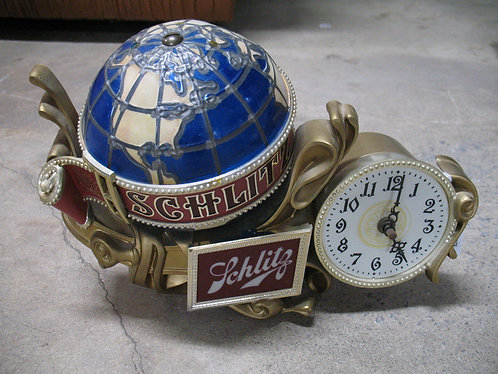 Vintage 1970's Schlitz Spinning Globe Electric Clock