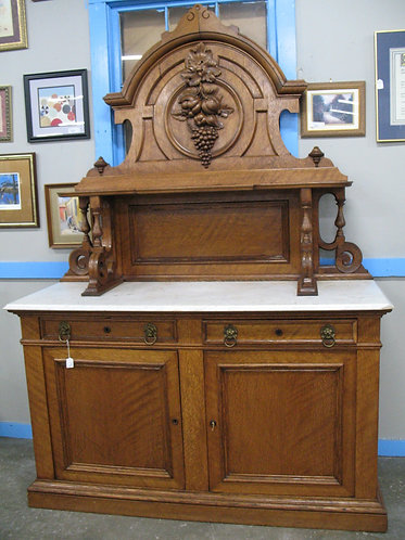 Antique Tiger Oak Marble Top Server with Fruit Carved Top