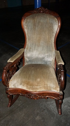 Antique carved upholstered rocking chair