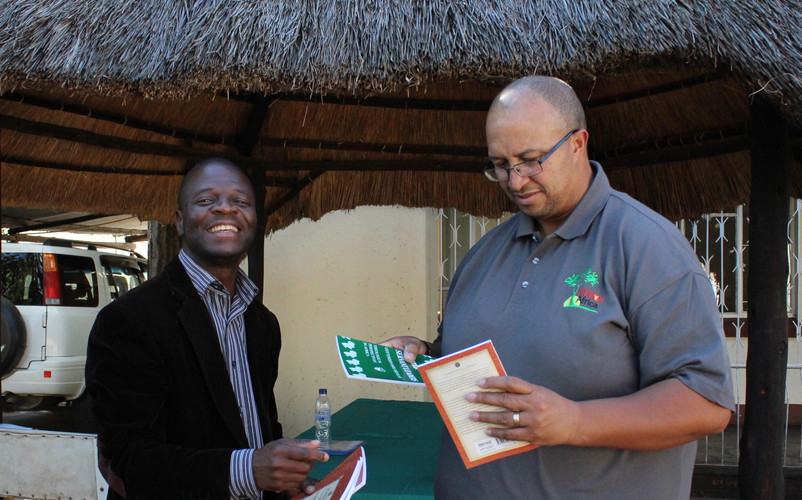 Handing out leadership material in Zimbabwe