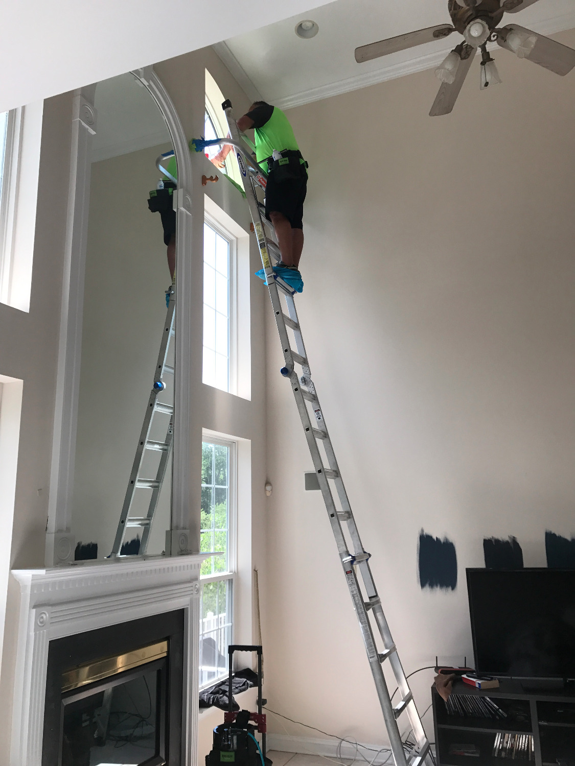 Window tinting on ladder