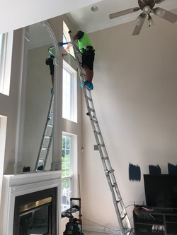 Window tinting on a ladder