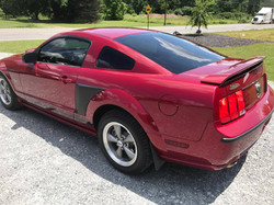 Red mustang with window tint