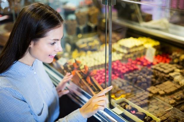 a woman choosing chocolate