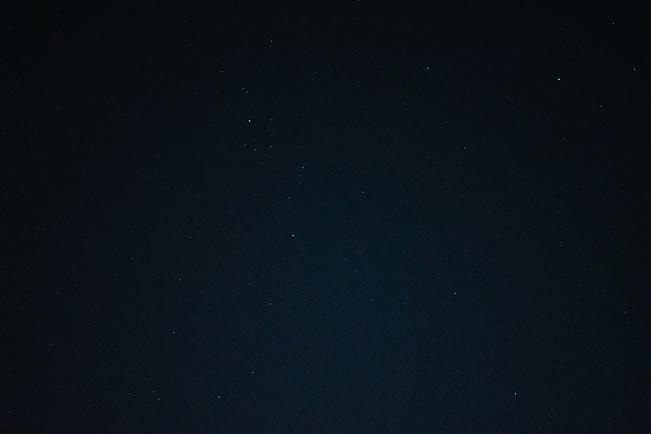 grainy deep blue starry sky